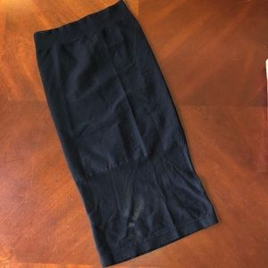 Stretchy mesh and ribbed pencil skirt.